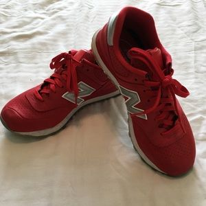 Red New Balance tennis shoes